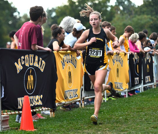 HF-L's Casey Walike crosses the finish line in the Tony Canali Memorial Race (girls varsity AA - seeded medium schools) during the 55th Annual McQuaid Invitational at Genesee Valley Park, Saturday, Sept. 28, 2019.