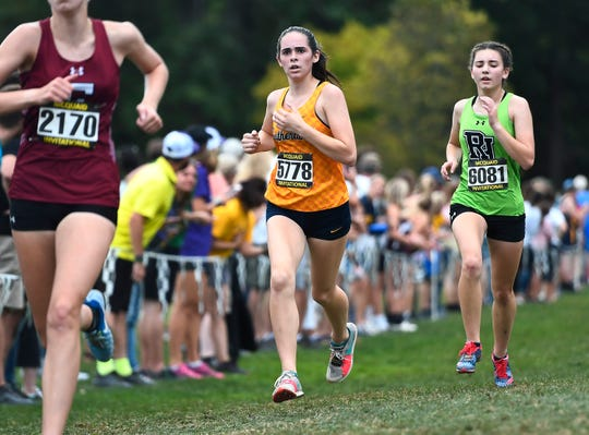 Pittsford Sutherland's Ellie Fantauzzo approaches the finish line in the girls varsity AA-2 race (unseeded medium/large schools) during the 55th Annual McQuaid Invitational at Genesee Valley Park, Saturday, Sept. 28, 2019.
