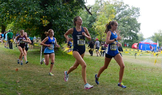 Irondequoit's Candace Tytler, right, and Brighton's Eilee Ossont run in the Tony Canali Memorial Race (girls varsity AA - seeded medium schools) during the 55th Annual McQuaid Invitational at Genesee Valley Park, Saturday, Sept. 28, 2019.