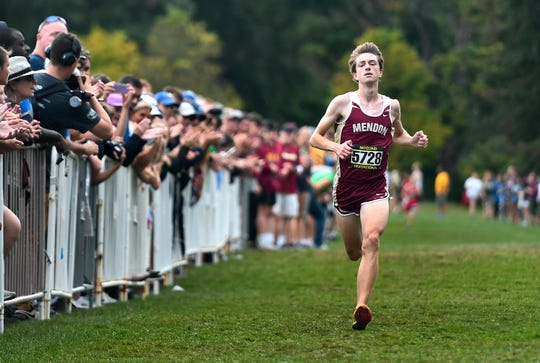 Pittsford Mendon's Sam Lawler approaches the finish line to win the Jason DeJoy Memorial Race (boys varsity AA - seeded medium schools) during the 55th Annual McQuaid Invitational at Genesee Valley Park, Saturday, Sept. 28, 2019.