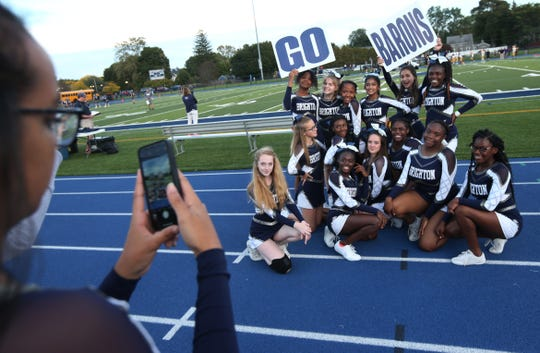 Brighton High cheerleaders pose for photos before the game as they get ready to cheer on the Barons against Greece.
