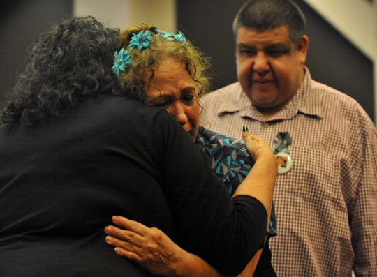 The grandmother of Joseph Anthony Aguilera gets a hug. Aguilera was gunned down at age 21. Salinas Parents of Murdered Children chapter hosts Day of Remembrance for victims of violence. Sept. 27, 2019.