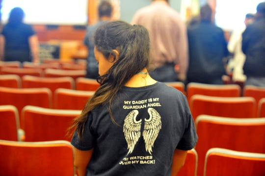 "A young girl stands in a t-shirt that says ""My daddy is my guardian angel."" Salinas Parents of Murdered Children chapter hosts Day of Remembrance for victims of violence. Sept. 27, 2019."