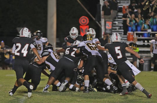 The Bearcat defense makes a stand near the end zone Friday, Sept. 27, 2019.