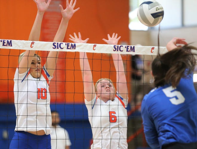 San Angelo Central High School's Nadia Fierro (left) and Chelsea Weldon go up for a block during a volleyball match against Weatherford at Babe Didrikson Gym Friday, Sept. 27, 2019. Weatherford won in straights sets in a showdown of District 3-6A co-leaders.