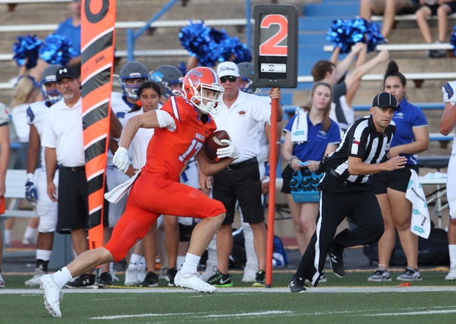San Angelo Central's Tanner Dabbert runs after a catch against Weatherford on Friday, Sept. 27, 2019.