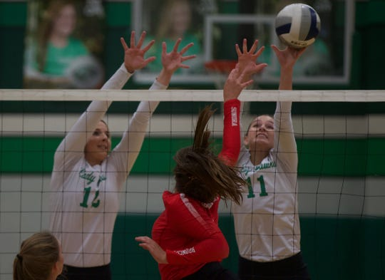 Lauren Scherr, far left, and Kylie Phillips, far right, try to block a shot for Wall on Saturday, Sept. 28, 2019.