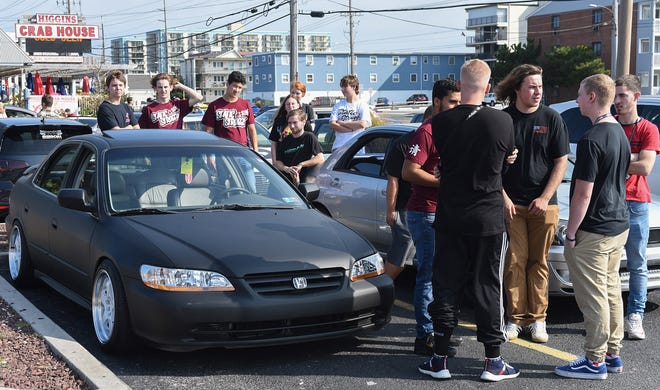 Spectators look at cars in the parking lot of the shopping center at 127th St. at the unofficial H2Oi event in Ocean City Saturday, September 28, 2019.