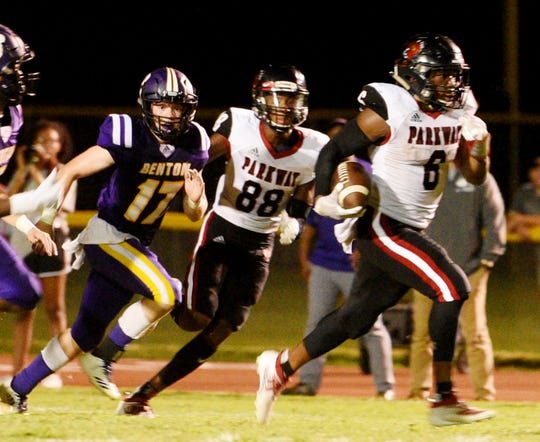 Parkway's Jamall Asberry pulls away from the Benton defense Friday night on the way to one of his five touchdowns.