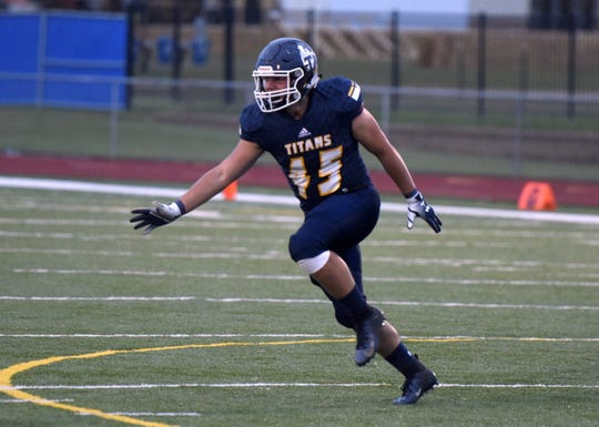 Tea Area's PJ Parmelee celebrates after recording a tackle for loss against Madison on Friday, Sept. 27, in Tea.