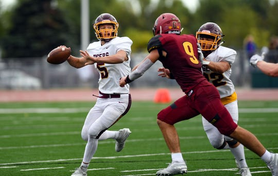 Harrisburg quarterback Jack Teigan looks to make a pass in a game against Sioux Falls Roosevelt on Friday, September 27, at Howard Wood Field in Sioux Falls.