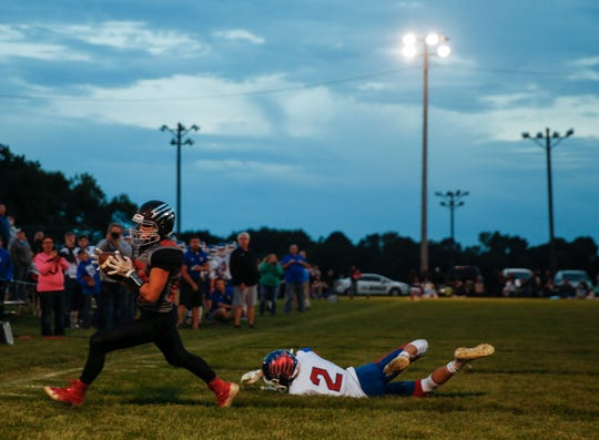 Viborg-Hurley linebacker and running back Tate Kessler (24) makes a touchdown during the game against Parker on Friday, Sept. 27, 2019.