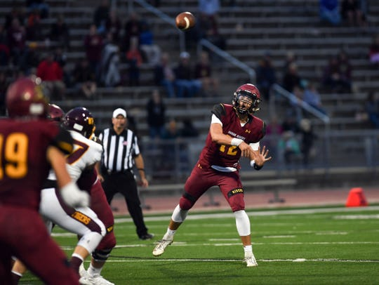 Roosevelt quarterback Brady Dannenbring throws a pass during a game against Sioux Falls Roosevelt on Friday, September 27, at Howard Wood Field in Sioux Falls.