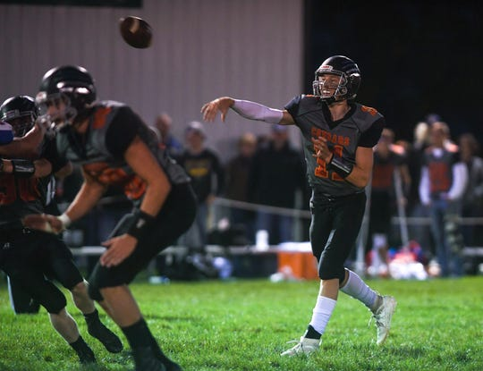 Viborg-Hurley quarterback and defensive back Chase Mason (11) passes the ball during the game against Parker on Friday, Sept. 27, 2019.