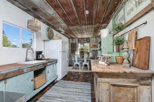 The floor in the old kitchen was shot, so the Russells took roofing planks and reused them for flooring.