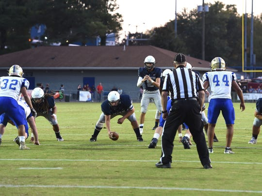 Staunton lines up for the snap during Friday night's game with Central.