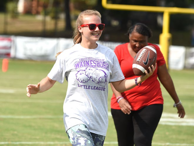 Kate Collins sixth-grade English teacher Katilyn Shull was part of the school's staff at Saturday's youth football game. The staff was supporting their students who were playing.