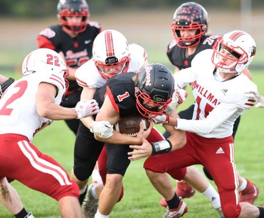 Jack Steil fights off multiple defenders to reach for the end zone against Willmar Friday, Sept. 27, 2019, at ROCORI High School.