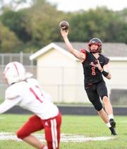 ROCORI quarterback Jack Steil throws a pass against Willmar Friday, Sept. 27, 2019, at ROCORI High School.