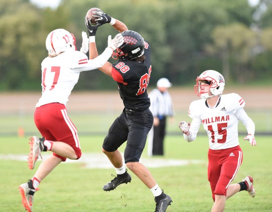 ROCORI wide receiver Andrew Anderson jumps up to make a catch against Willmar Friday, Sept. 27, 2019, at ROCORI High School.