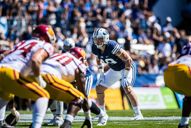 Dixie High grad and current BYU linebacker Payton Wilgar (49) surveys the offense during a game against then-No. 24 USC.