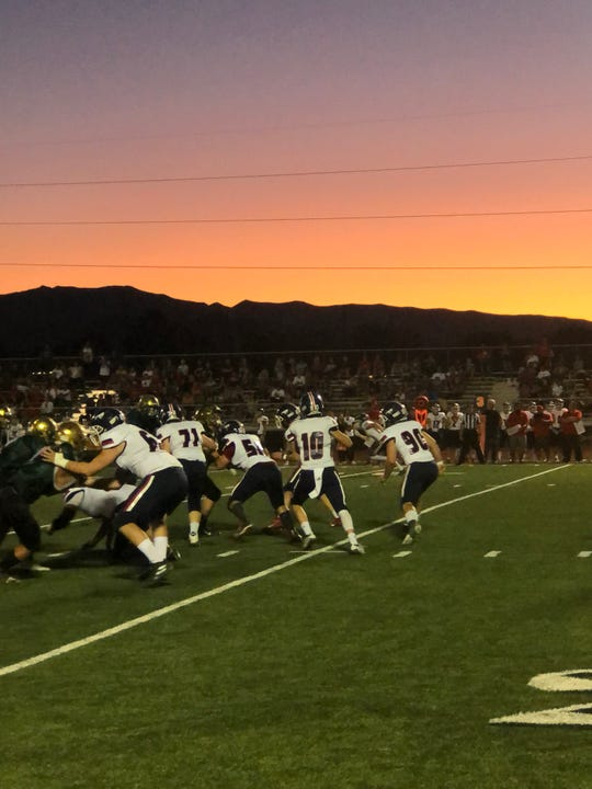 Crimson Cliffs QB Chase Hansen drops back to pass during Snow Canyon's win over the Mustangs on Friday, Sept. 27, 2019.