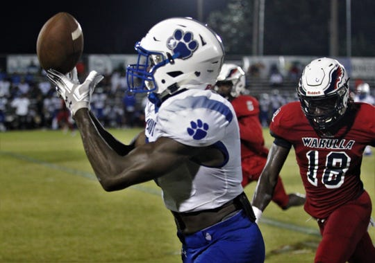 Godby receiver Avery Boyd makes a finger-tip grab for an 85-yard touchdown as Wakulla beat Godby 35-25 on Friday, Sept. 27, 2019.