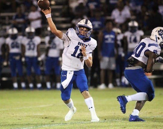 Godby quarterback Trey Fisher throws a pass as Wakulla beat Godby 35-25 on Friday, Sept. 27, 2019.