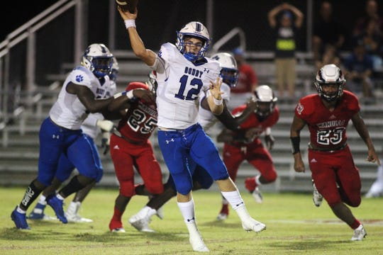 Godby quarterback Trey Fisher throws a pass on the run as Wakulla beat Godby 35-25 on Friday, Sept. 27, 2019.