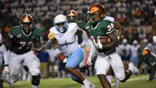 FAMU running back Bo Kendrick looks to gain a first down versus Southern on Saturday, Sept. 21, 2019.