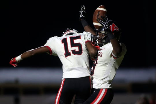 NFC receiver Deandrae McCray (9) celebrates a touchdown with teammate Micah McCorvey during the Eagles' 23-21 loss to Maclay on Sept. 27, 2019.