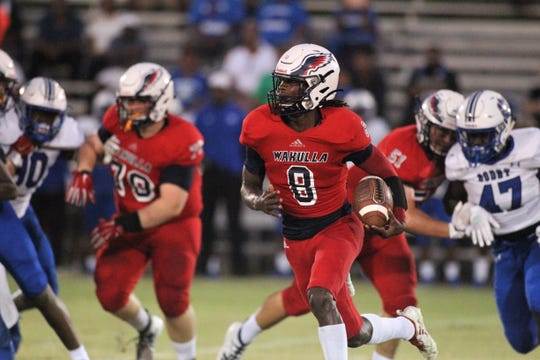 Wakulla quarterback Jaylon Worsham takes off on a big run as the War Eagles beat Godby 35-25 on Friday, Sept. 27, 2019.