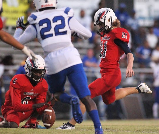 Wakulla freshman Chase Linville kicks an extra point as the War Eagles beat Godby 35-25 on Friday, Sept. 27, 2019.