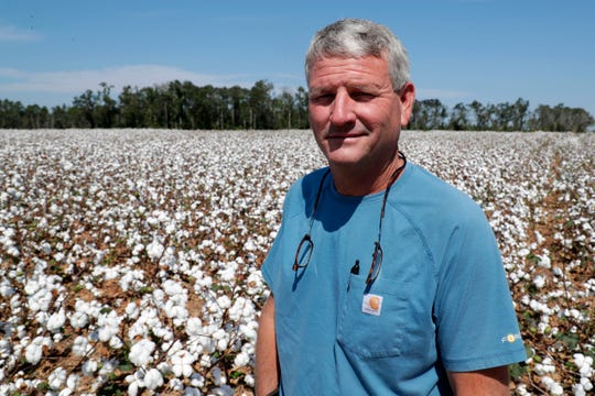 Greg Mims, a cotton and peanut farmer in Seminole County, Georgia, poses for a photo in a field of cotton. His crops were destroyed last season when Hurricane Michael ripped through the Panhandle in Oct. 2018.