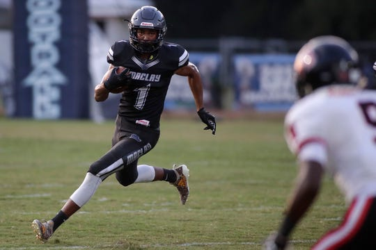 Maclay's Robert Parker-Crawford takes off on a run as the Marauders beat NFC 23-21 on Friday, Sept. 27, 2019.