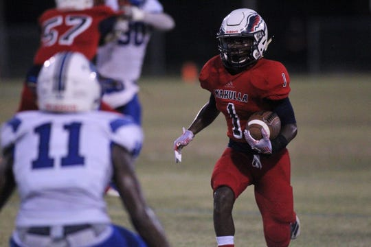 Wakulla running back Jakari Ervin takes a speed sweep for big yards as the War Eagles beat Godby 35-25 on Friday, Sept. 27, 2019.