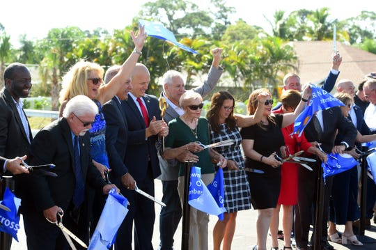 Port St. Lucie city officials and elected dignitaries cheer after a ribbon cutting to officially open the Walter B. England III Memorial Bridge at the Crosstown Parkway Extension Project grand opening on Saturday, Sept. 28, 2019. Walter B. England III was a former city engineer who worked for the city for more than 20 years. The City Council named it in his memory in 2009.