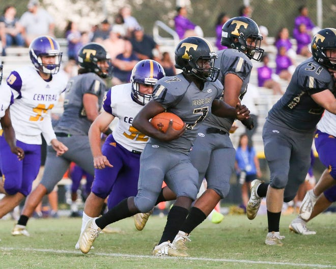 Treasure Coast quarterback Turk Watkins runs the ball against Fort Pierce Central on Friday, Sept. 27, 2019.