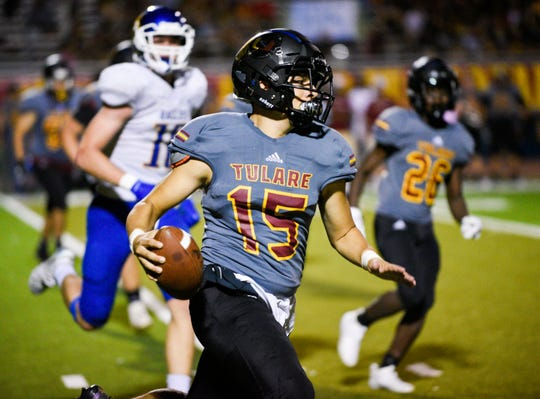 QB Jorge Gonzalez of Tulare Union gains yards against Bakersfield Christian in non-league football on Friday, Sept. 27, 2019.