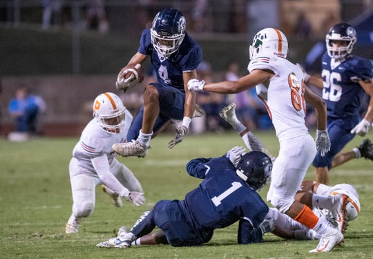 Redwood's Diamond Davis runs against Porterville in a non-league high school football game on Friday, September 27, 2019.