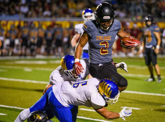 Tulare Union RB John White runs against  Bakersfield Christian in non-league football on Friday, Sept. 27, 2019.