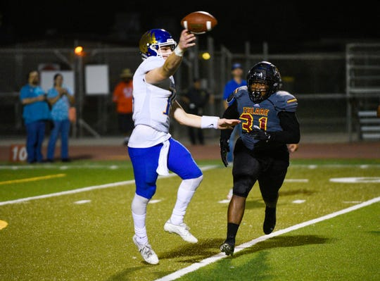 Tulare Union's Donavan Smith pressures Bakersfield Christian's quarterback in non-league football on Friday, Sept. 27, 2019.