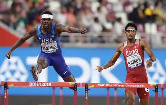 Rai Benjamin, of the United States, and Abderrahman Samba, of Qatar, compete in a men's 400m hurdles semifinal at the World Athletics Championships in Doha, Qatar, Saturday, Sept. 28, 2019.