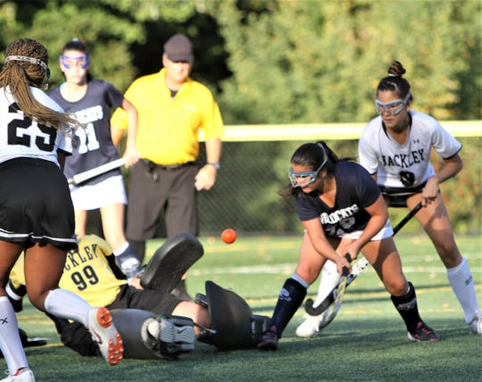 Olivia Friedberg of Rye Country Day (blue) can't get the ball past Hackley's Jenny Canoni (99) on this play but Friedberg went on to score twice during a 3-0 Wildcat win Sept. 27, 2019.
