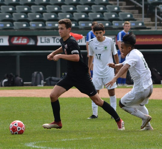 Nyack midfielder Julian Brooks (8) works clear of Ramapo's William Chub in the second half of the Indian's win at Palisades Credit Union Park on Sept. 28, 2019.
