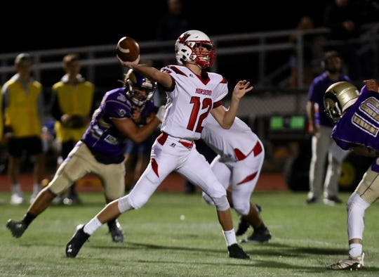 Sleepy Hollow quarterback Ben Good throws a pass during game at Clarkstown North High School on Friday, September 27, 2019.