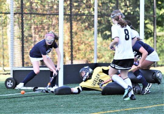 Hackley's Jenny Canoni makes diving save and prevents Rye Country Day's Amelia Lower (l) from getting the rebound during Sept. 27, 2019 game