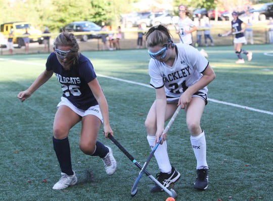 Rye Country Day's Caroline Keating (l) and Hackley's Catie O'Rourke (r) battle for the ball Sept. 27, 2019.