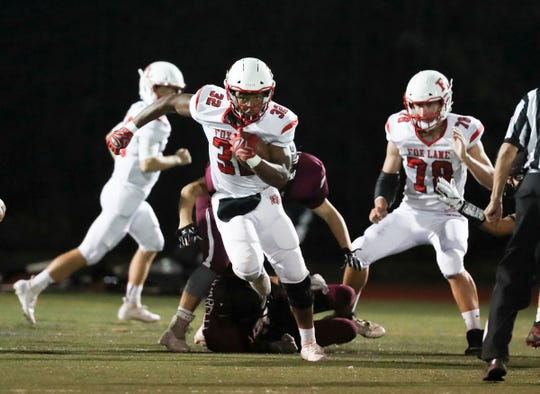 Fox Lane's Michael Washington (32) with the carry during their 20-14 overtime win over Harrison at Harrison High School on Friday, September 27, 2019.