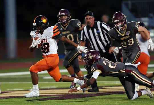 White Plains' Christian Young (28) looks for some running room in the Arlington defense during football action at Arlington High School in LaGrange Sept. 27, 2019.